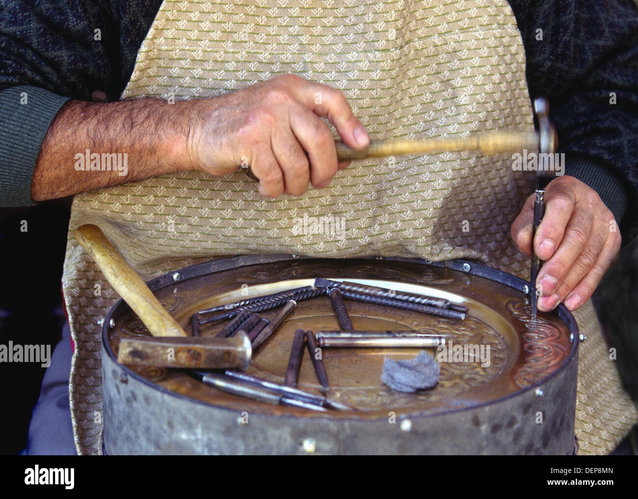 Chiseller Making a Brass Plate. - Stock Image