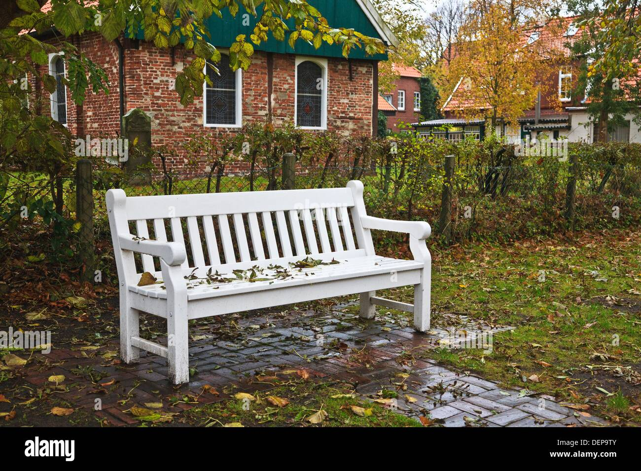 Deserted bench in the autumn on the east frisian island of Spiekeroog, Lower Saxony, Germany, Europe Stock Photo