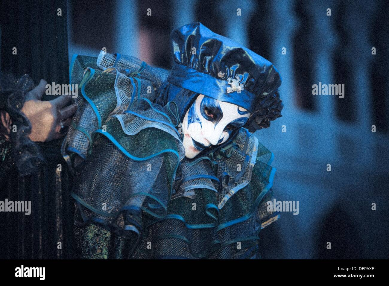 A mystical view of a masked harlequin at the carnival in Venice, Italy, Europe - Stock Image