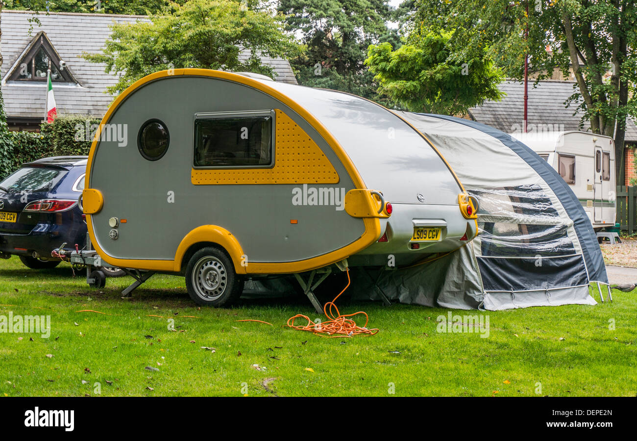 Teardrop shaped T@b Caravan and awning, on a pitch at the Caravan Club site at Crystal Palace, London,  England. - Stock Image
