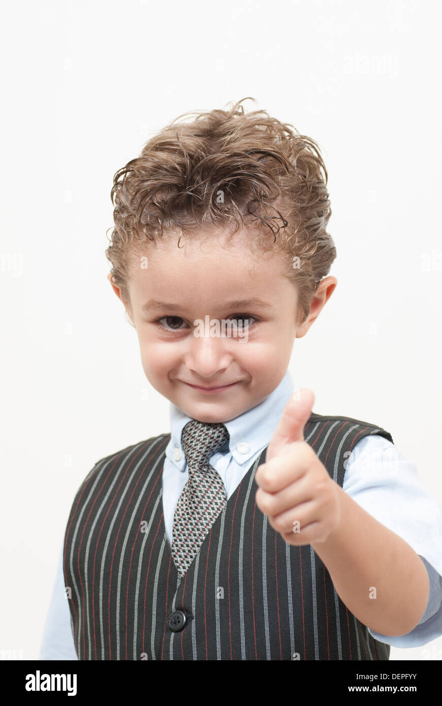 Boy in waistcoat and tie thumbs up Stock Photo