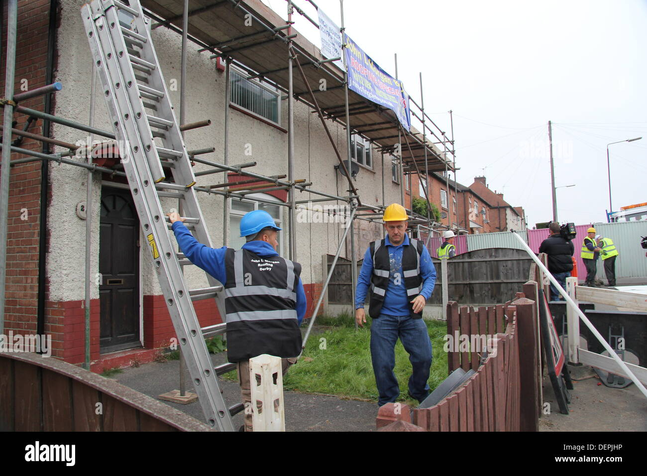 Derby, UK. 23 September 2013.  Contractors begin preliminary demolition work at 18 Victory Road, Allenton where the Philpott's six children died in a fire, and number 20, the semi-detached it adjoins. Derby City Council say the demolition process is likely to take up to three weeks; week one to prepare the site and a further two weeks to take down both properties, beginning with the outbuildings and roofing structures. A planning application for new housing on the site has been submitted. - Stock Image