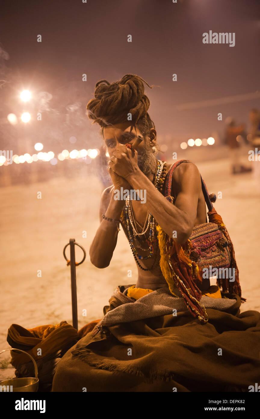 Sadhu smoking at Maha Kumbh, Allahabad, Uttar Pradesh, India - Stock Image