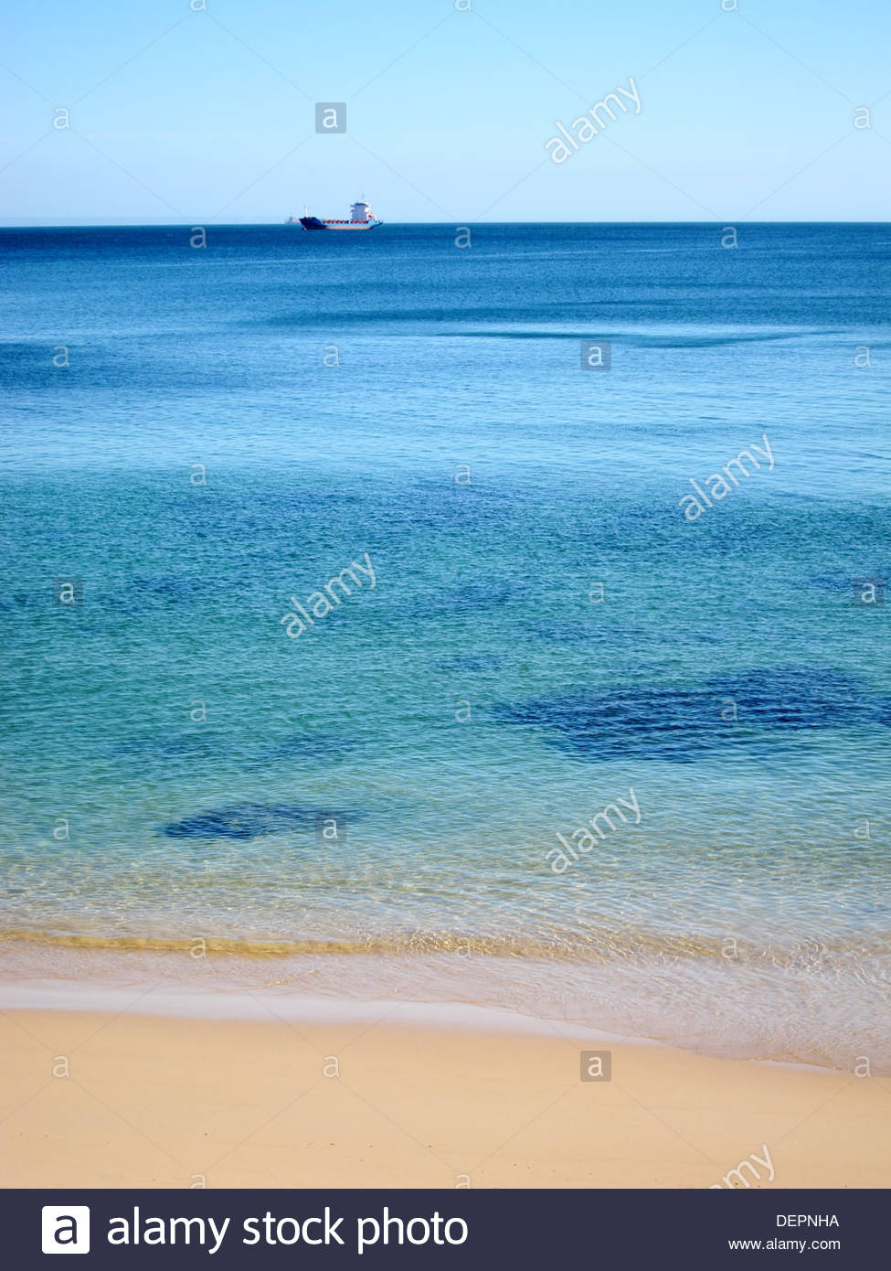 Beach with clear water and clean sand, Estoril, Portugal - Stock Image