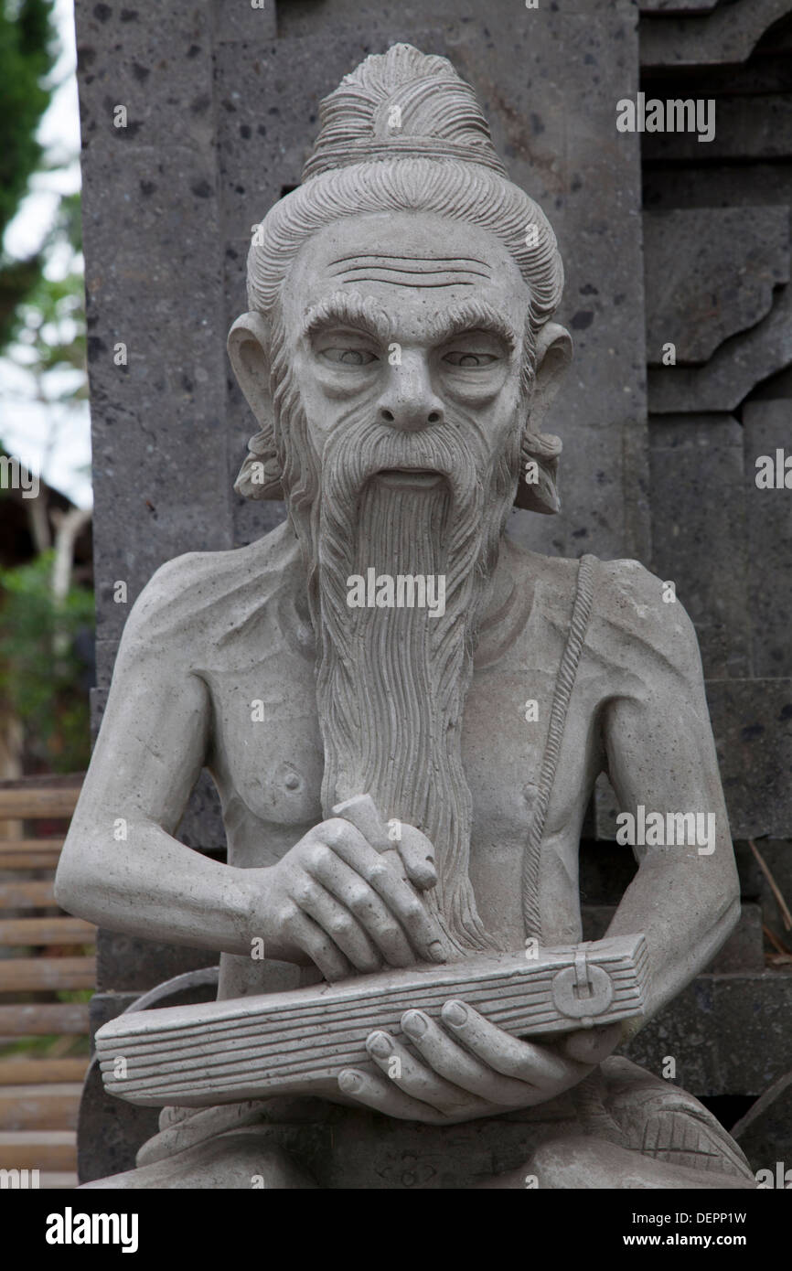 Stone carved statue gods bali stock photos