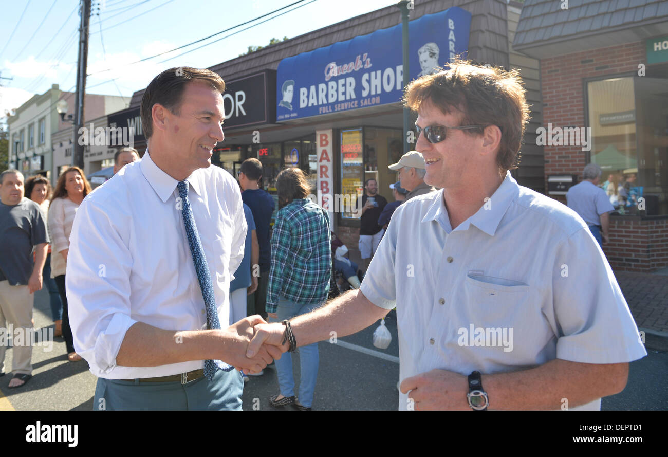 Bellmore, New York, U.S. 22nd September 2013. Former Nassau County Executive TOM SUOZZI (Democrat), who is running for his former office again, makes a campaign visit at the 27th Annual Bellmore Festival, featuring family fun with exhibits and attractions in a 25 square block area, with over 120,000 people expected to attend over the weekend. Credit:  Ann E Parry/Alamy Live News - Stock Image