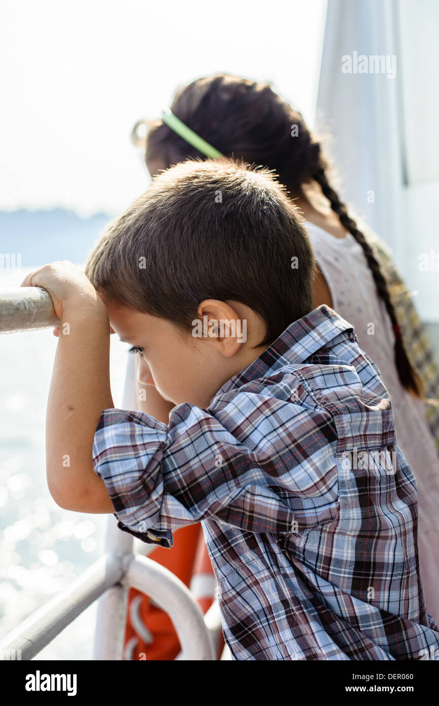 Children navigate on the steamer on Lake Maggiore, Italy - Stock Image