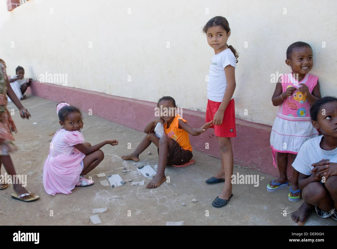 little girls playing in the street, Hell-Ville Andoany, Nosy Be island, Republic of Madagascar, Indian Ocean - Stock Image