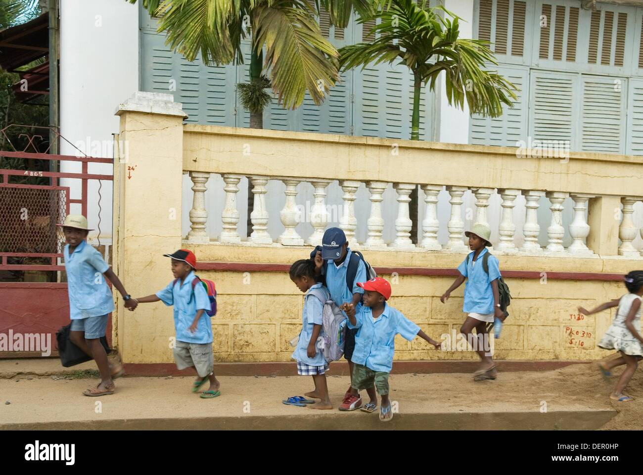 schoolchildren, Hell-Ville Andoany, Nosy Be island, Republic of Madagascar, Indian Ocean - Stock Image