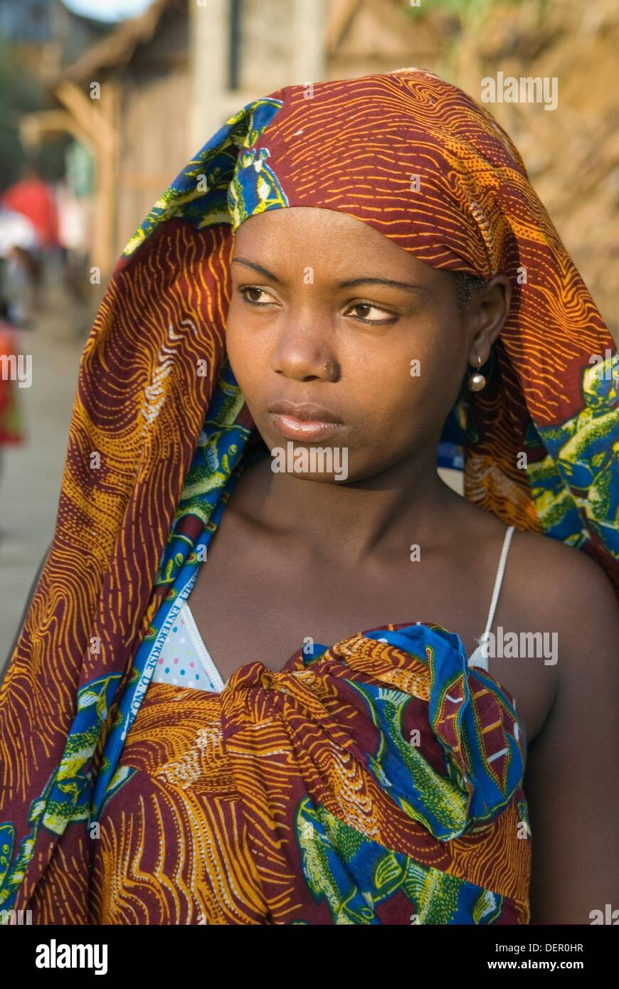 young malagasy woman, Hell-Ville Andoany, Nosy Be island, Republic of Madagascar, Indian Ocean - Stock Image
