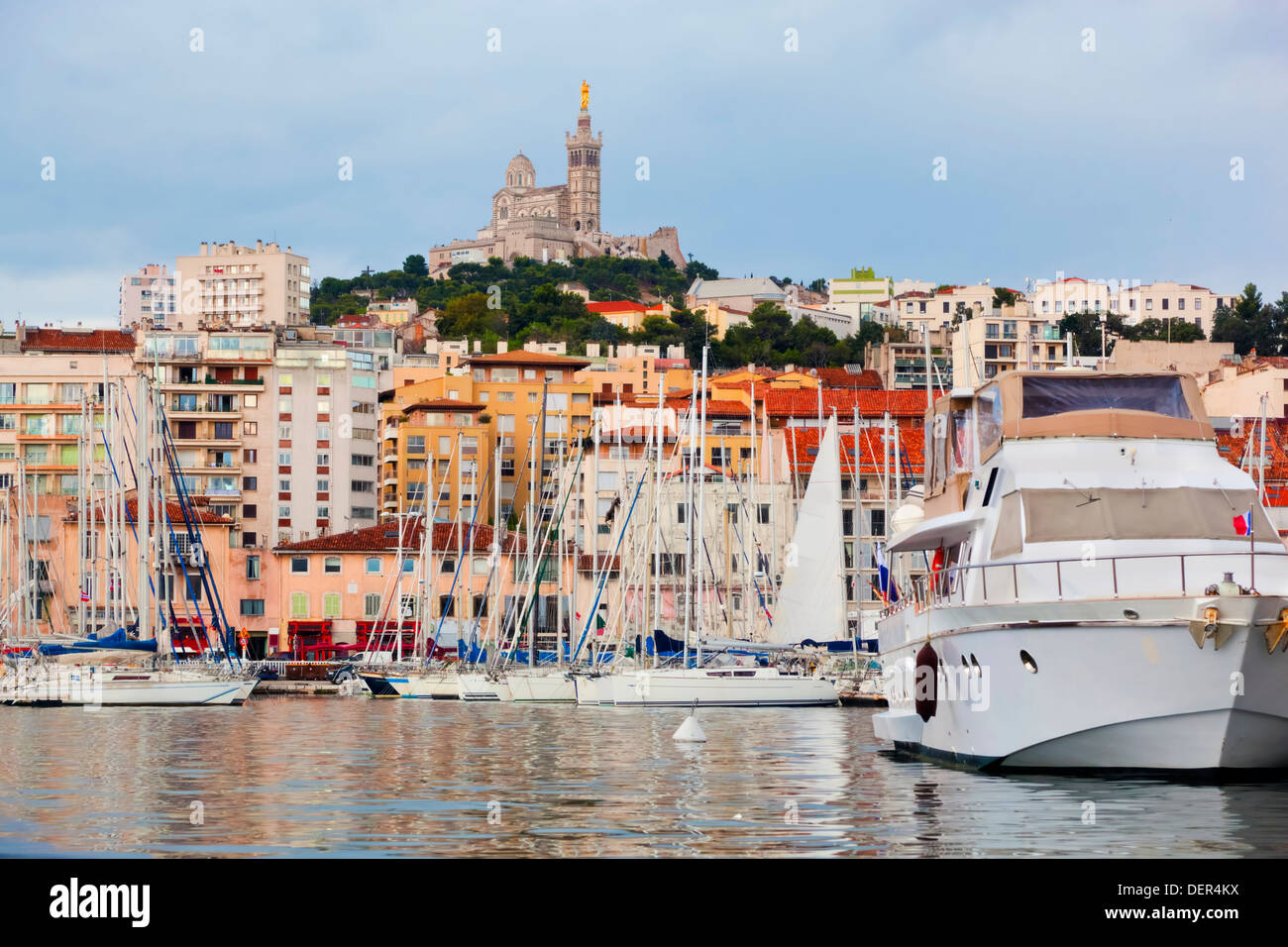 Marseille, France : The famous old port with a view of the Notre Dame de la Garde cathedral - Stock Image