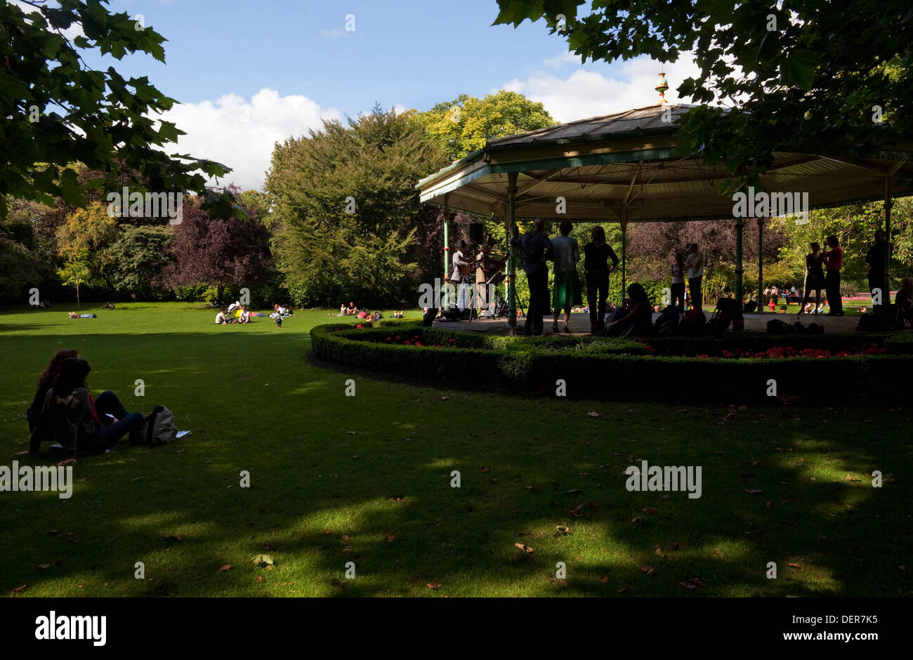Weekend entertainment on the bandstand in St Stephen's Green Park, Dublin City, Ireland. - Stock Image