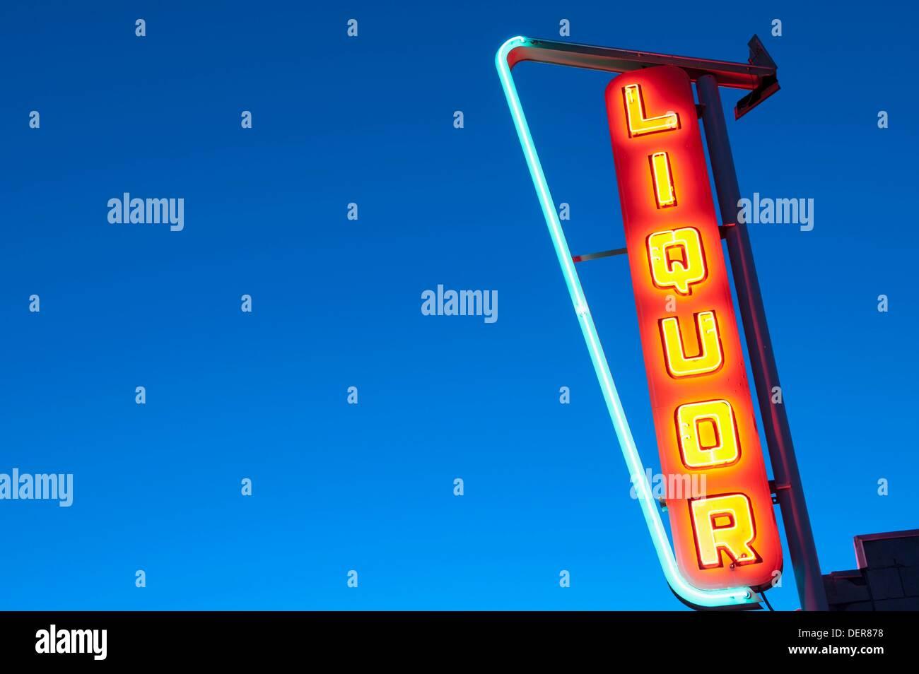 Needles, CA - A neon liquor sign shines in the dark along Historic Route 66 - Stock Image