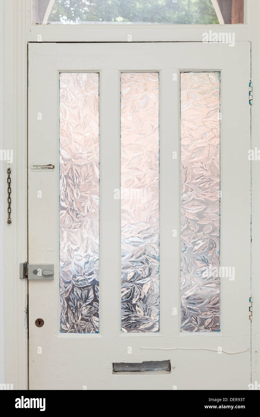 Interior view of an old front door with glass panels - Stock Image
