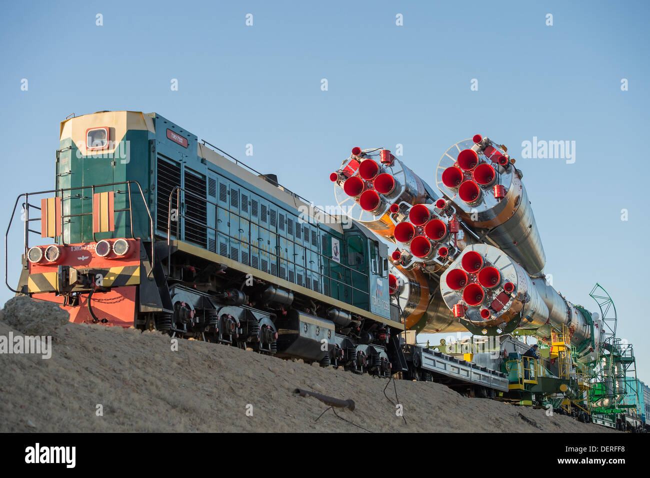 The Russian Soyuz rocket is rolled out to the launch pad by train at the Baikonur Cosmodrome September 23, 2013 in Baikonur, Kazakhstan. Launch of the rocket carrying the Expedition 37 crew to the International Space Station is scheduled for September 26. - Stock Image