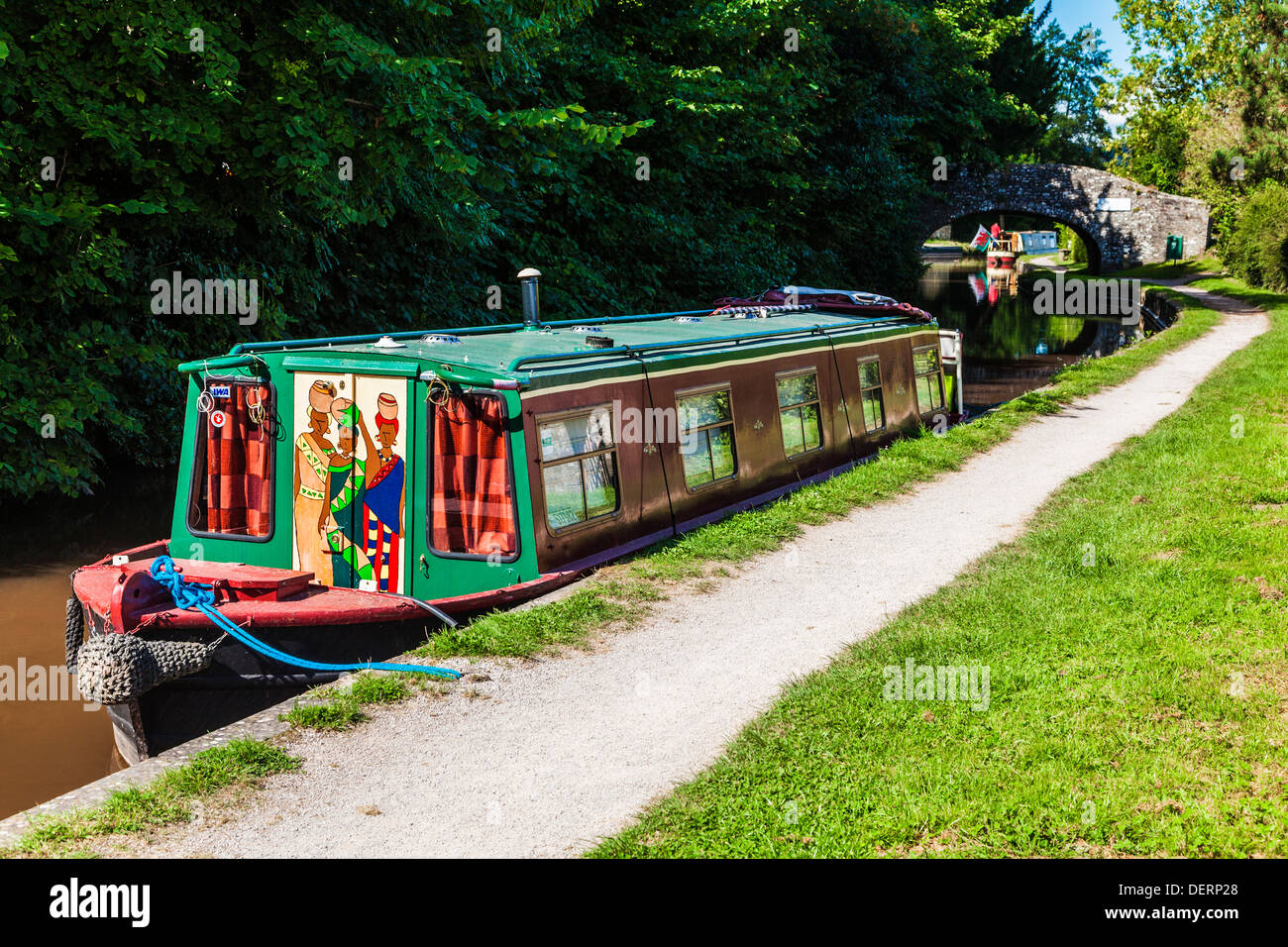 A narrowboat moored along the Monmouthshire and Brecon Canal in the Brecon Beacons National park near Pencelli. - Stock Image