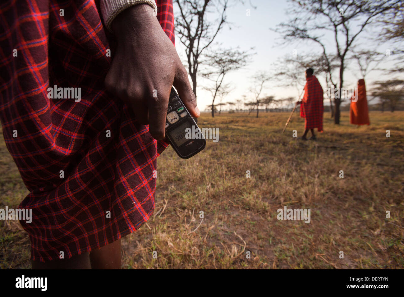 Maasai man holding a Nokia mobile phone, Mara Region, Kenya - Stock Image