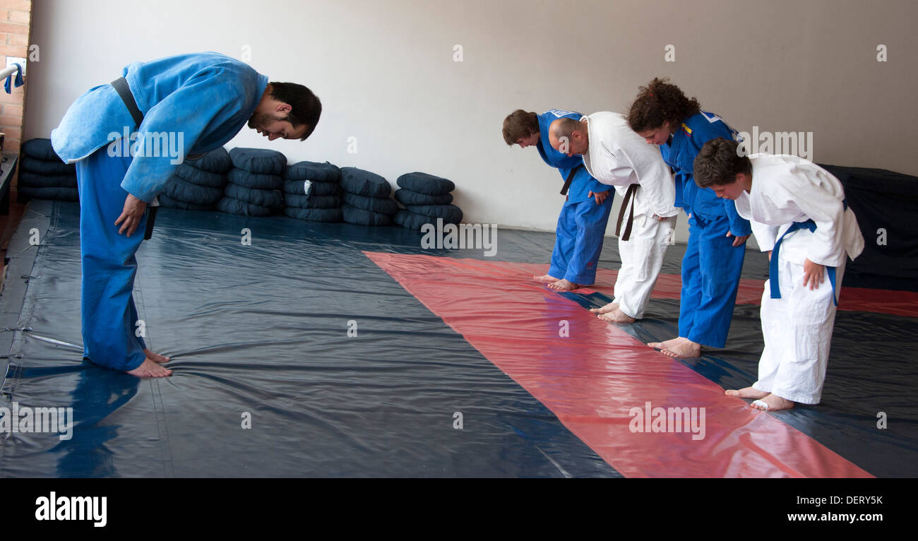 Bowing at the end of a judo lesson in Bogota, Colombia - Stock Image
