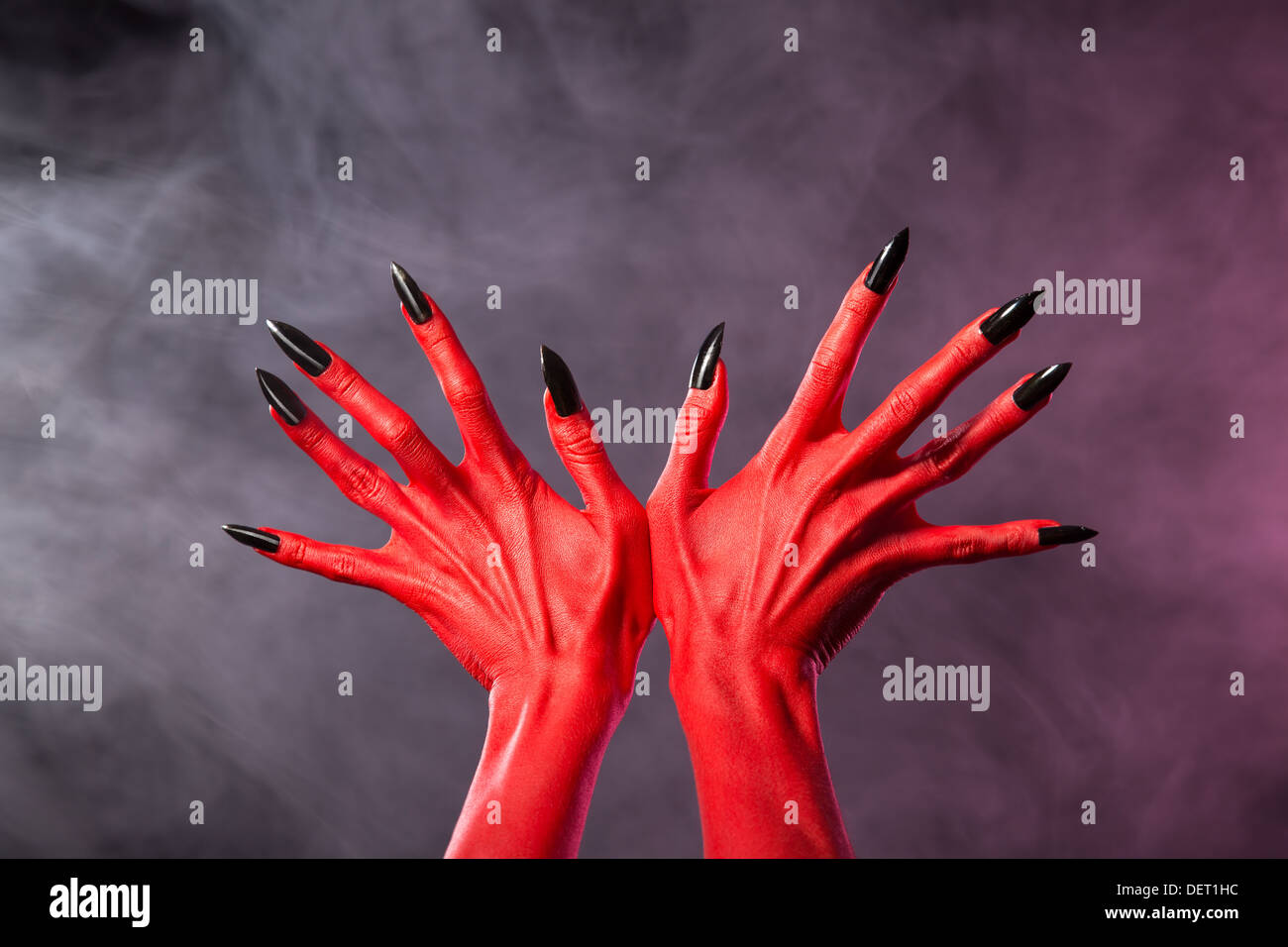 Red Devil Hands With Sharp Black Nails Extreme Body Art Studio Shot Stock Photo Alamy