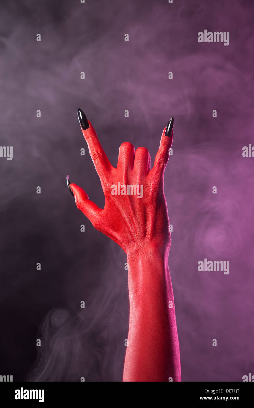 Heavy metal gesture, red devil hand with black nails, Halloween ...