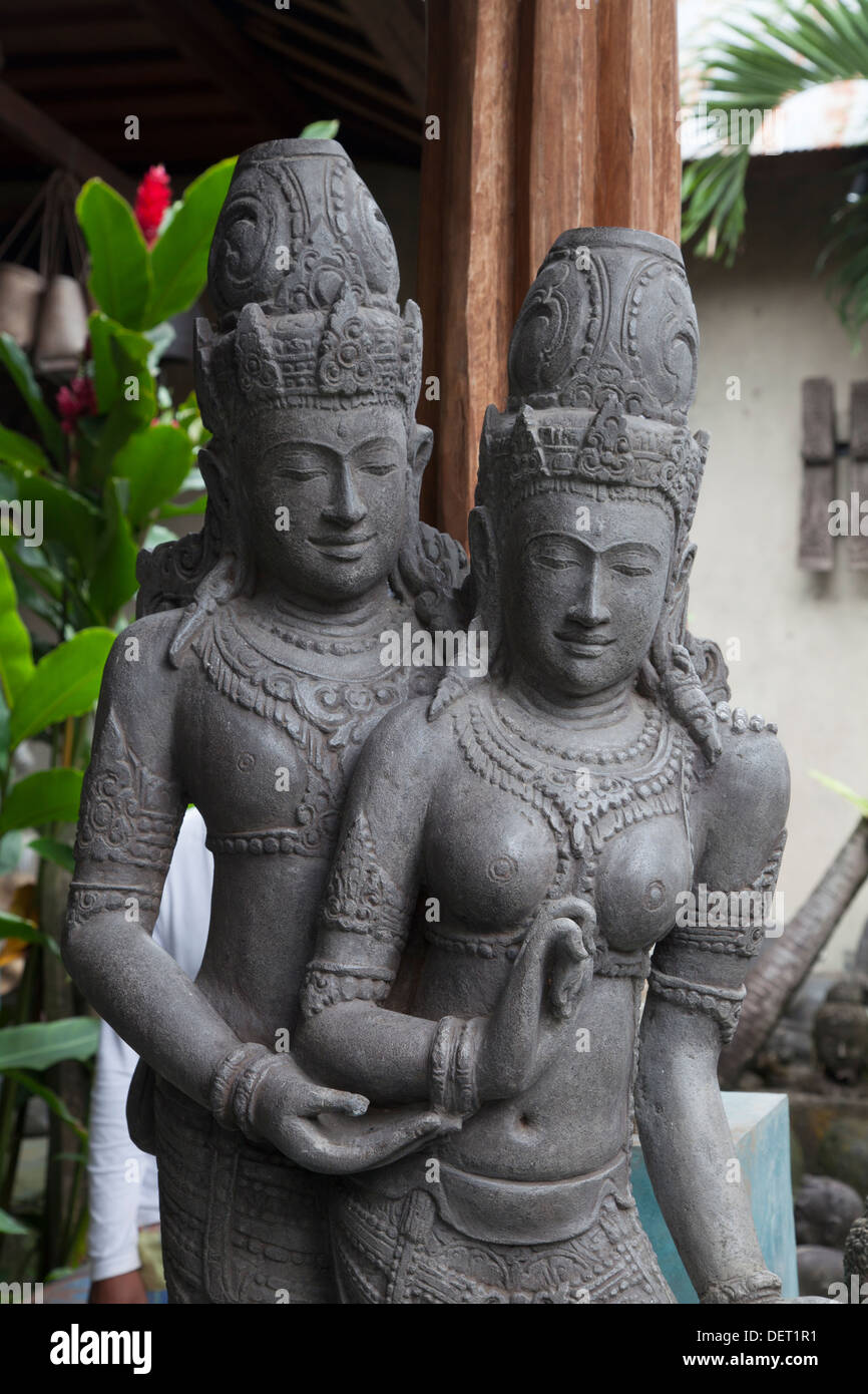 Indonesian stone statue couple man wife God gods deities religious religion holy tradition traditional belief worship - Stock Image