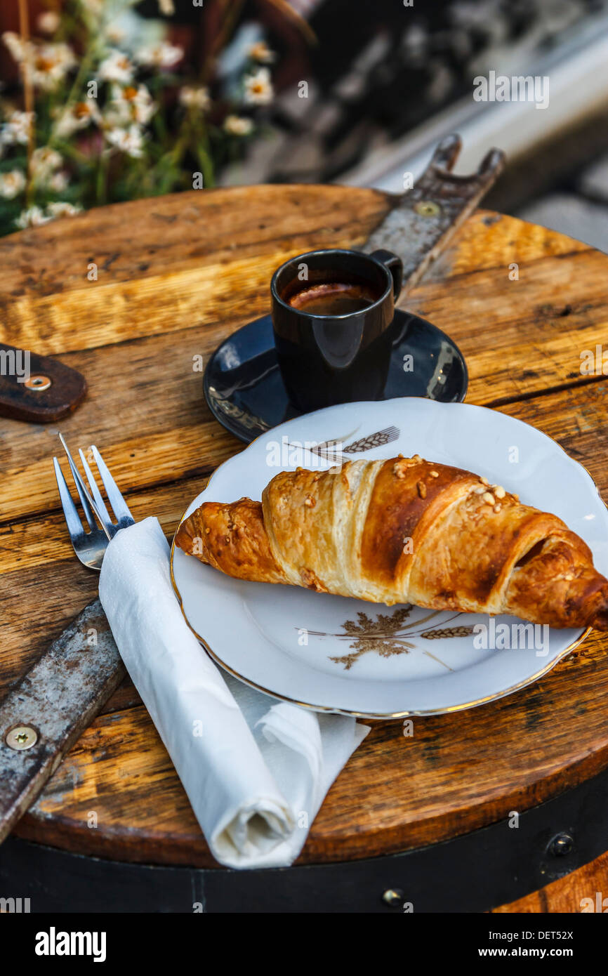 Croissant and coffee. - Stock Image