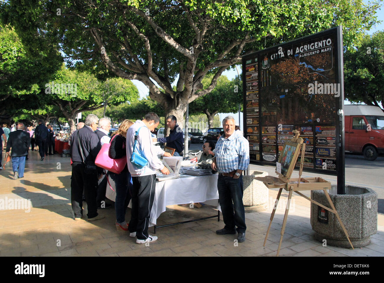 Tourists look at souvenirs for sale in the city of Agrigento. - Stock Image