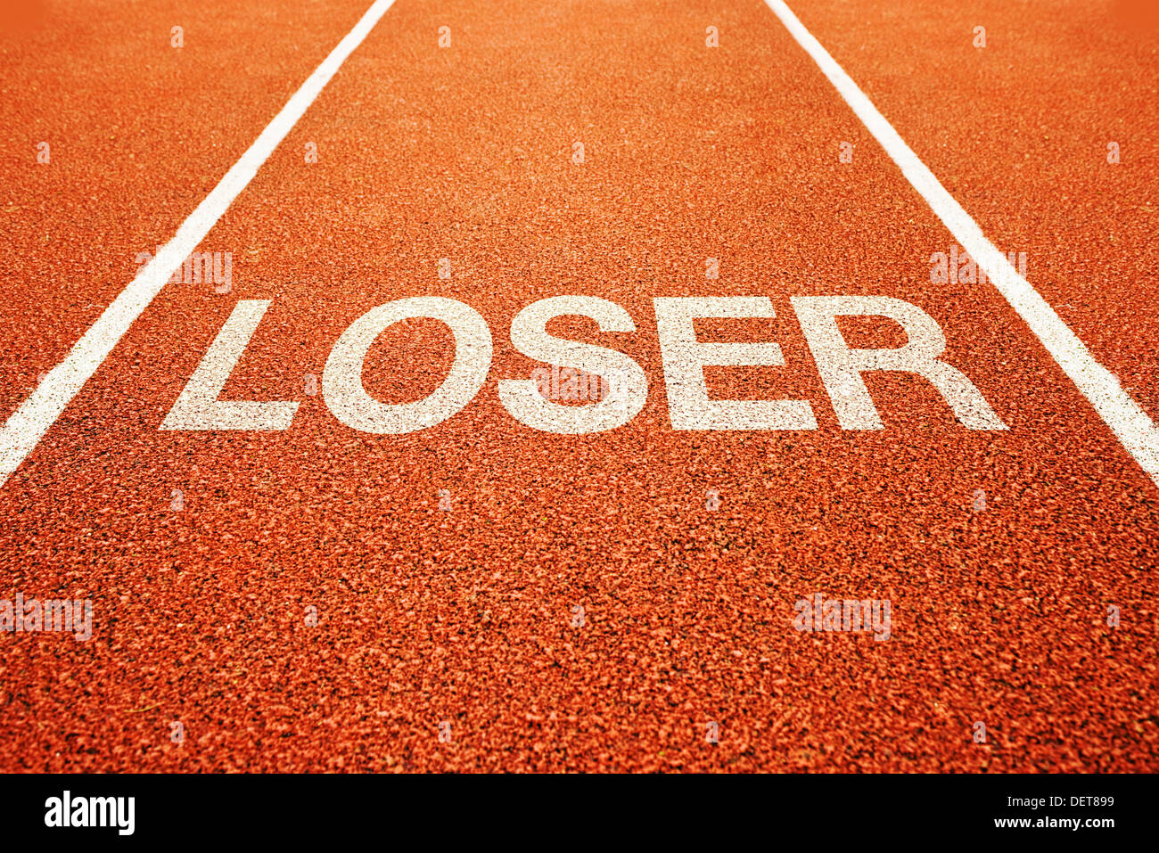Loser on athletics all weather running track - Stock Image