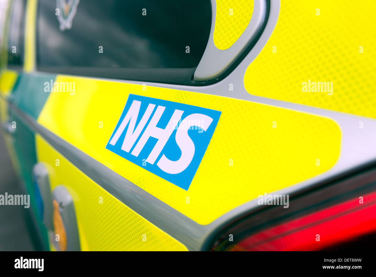 The detail of the NHS logo on a paramedic's ambulance car - Stock Image