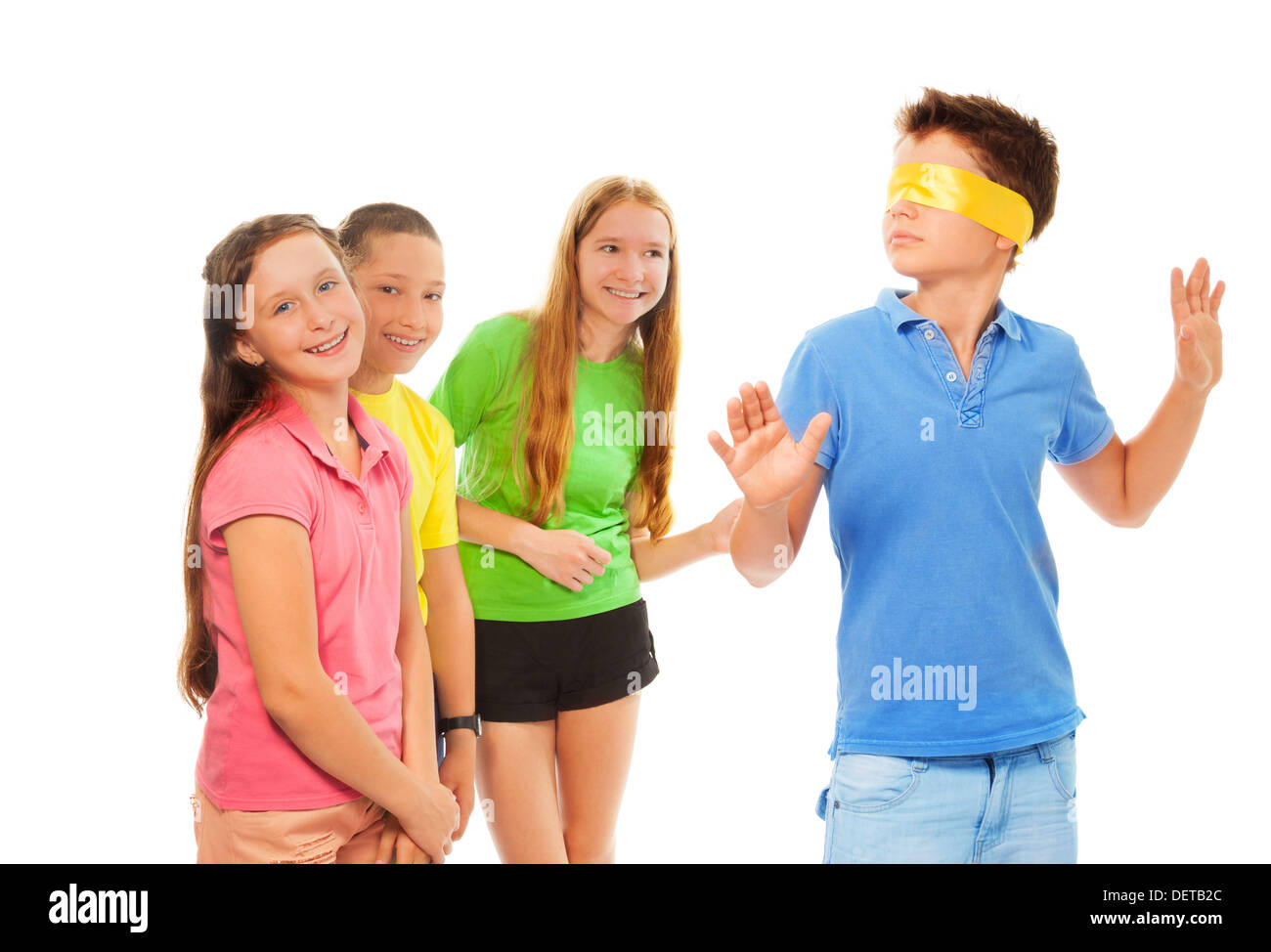 Boys and girls playing hide and seek with hidden eyes  - Stock Image