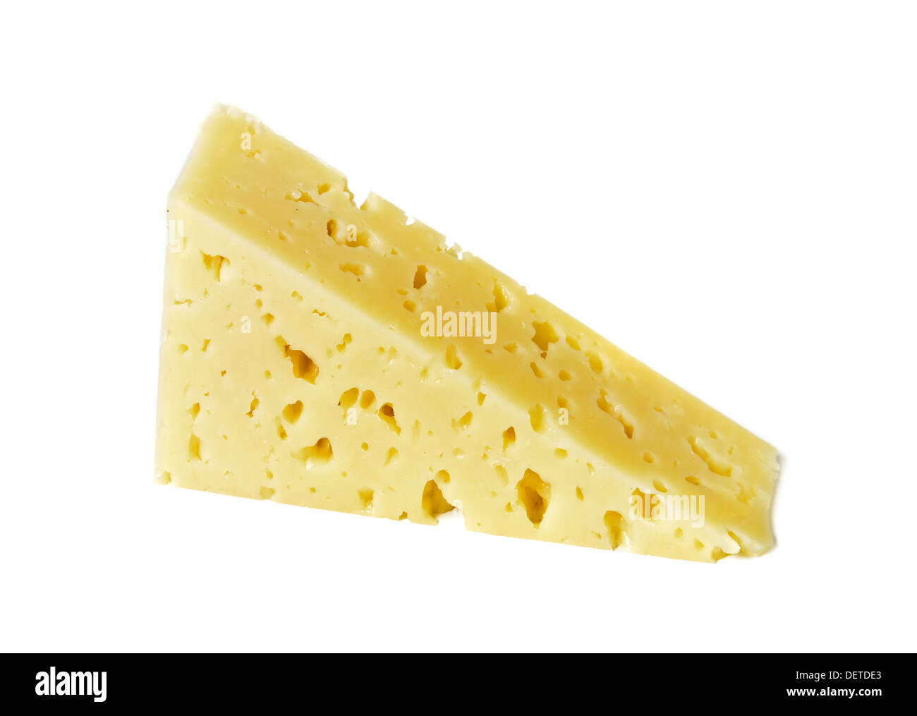 piece of Holland cheese over white - Stock Image