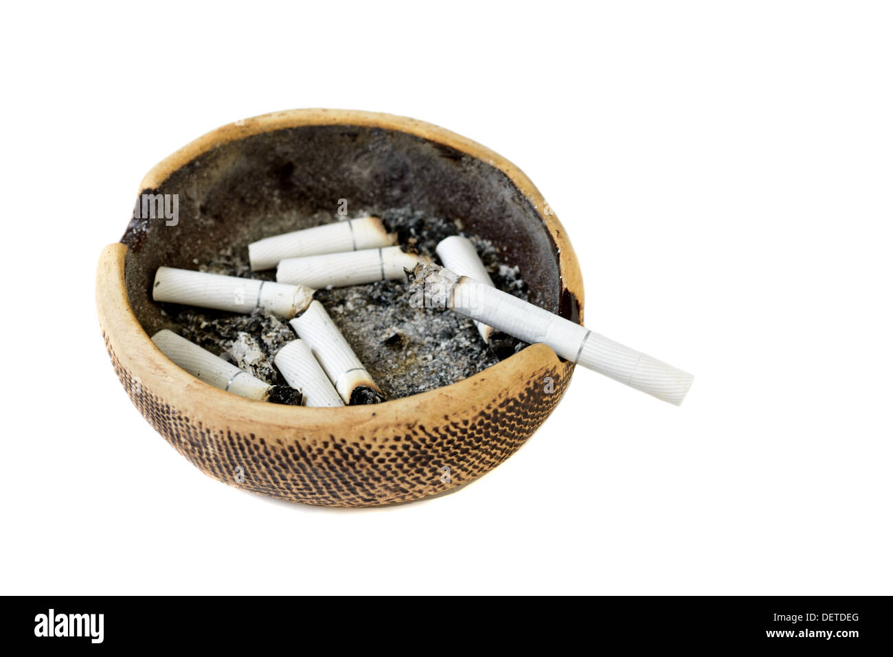 Dirty ashtray with cigarette ash and butts Stock Photo