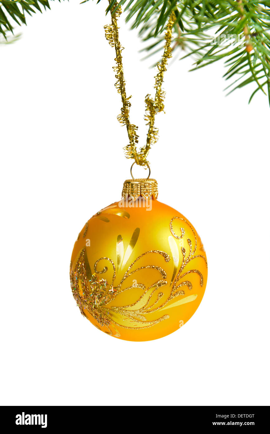 Christmas ball decoration on pine tree over white - Stock Image