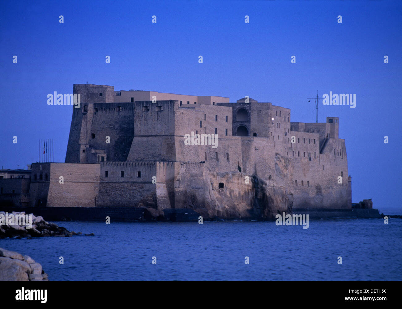 Castel dell'Ovo (1154) located on a small island in Naples - Stock Image