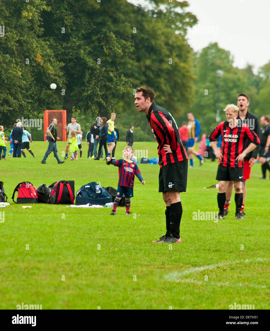 Sunday league football match in park - Stock Image