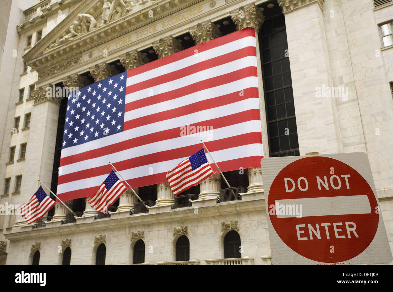 American flag draped in front of New York Stock Exchange.  New York, USA - Stock Image