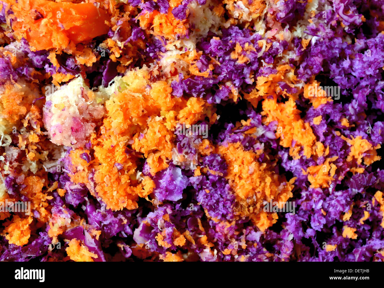 The beautiful colors and texture of such an ordinary, mundane thing as the remaining pulp of red cabbage, a lemon and carrots af - Stock Image
