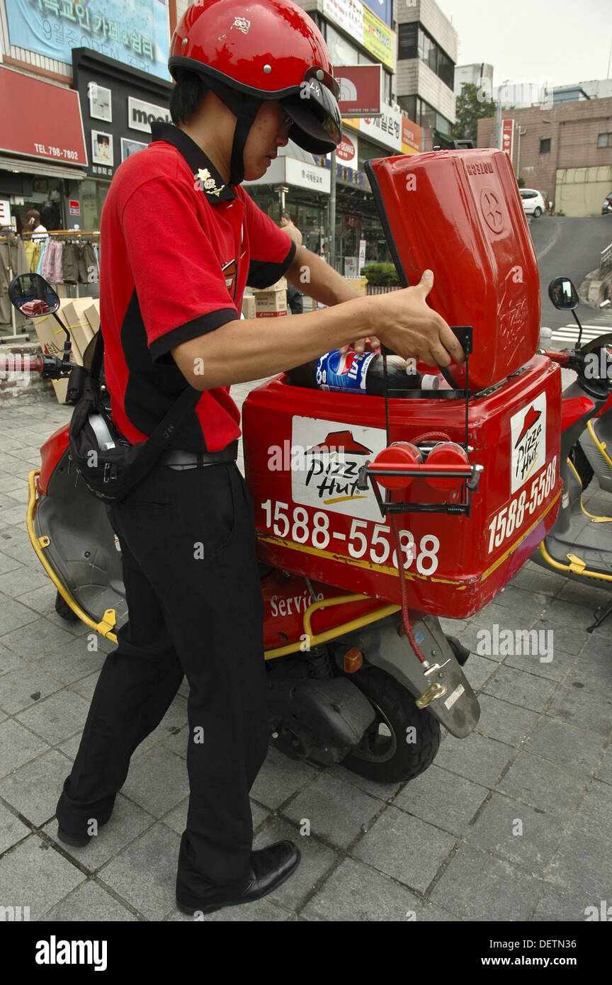 Pizza hut delivery man and scooter Seoul, Korea Stock Photo