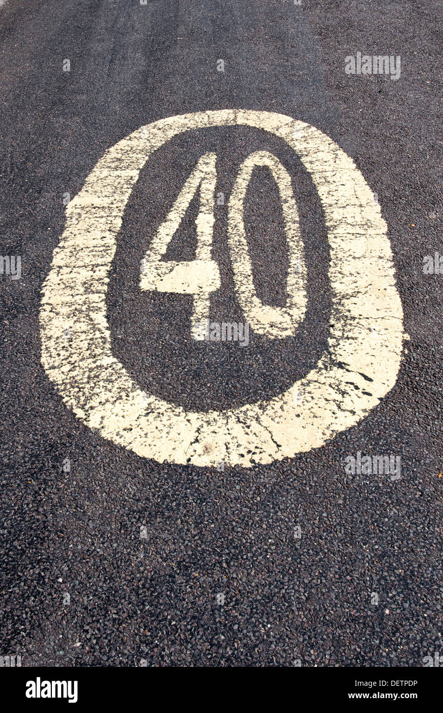 40 mph sign, forty miles per hour painted on the road - Stock Image