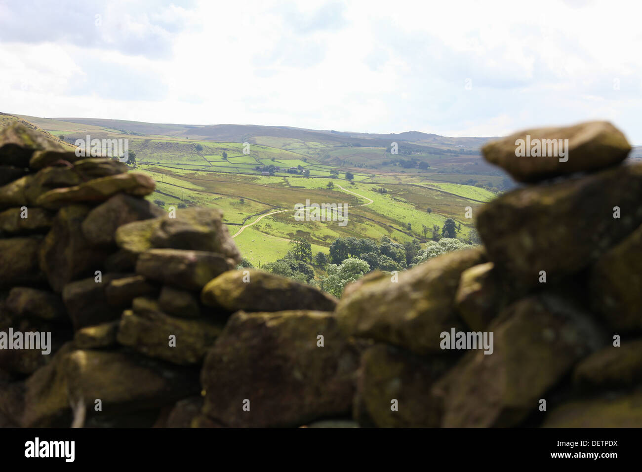 Looking through a dry stone wall towards Staffordshire from Cheshire moorlands - Stock Image