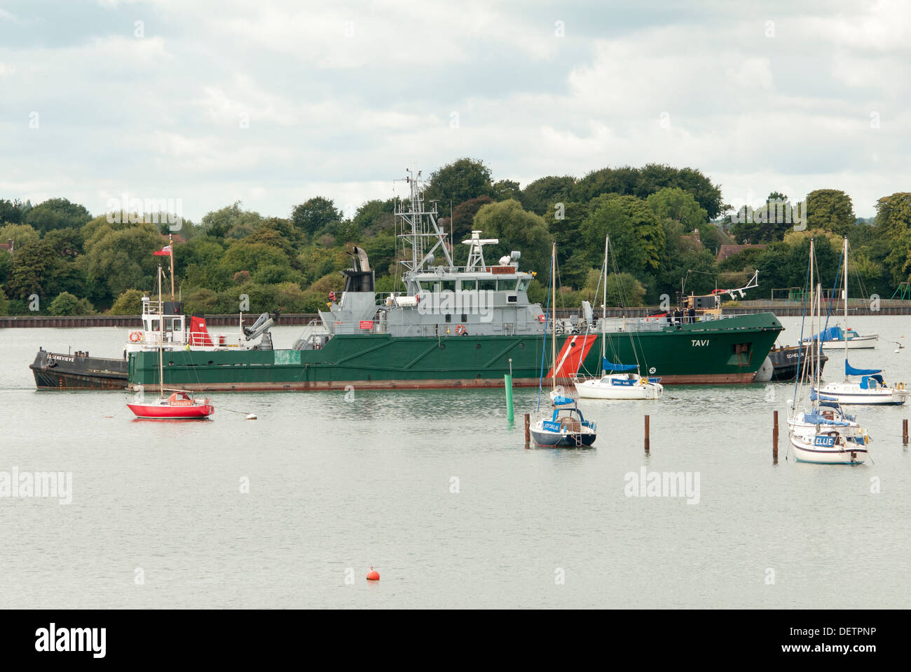 Tavi, large motor yacht being manoeuvred by tugs in Portsmouth Harbour - Stock Image