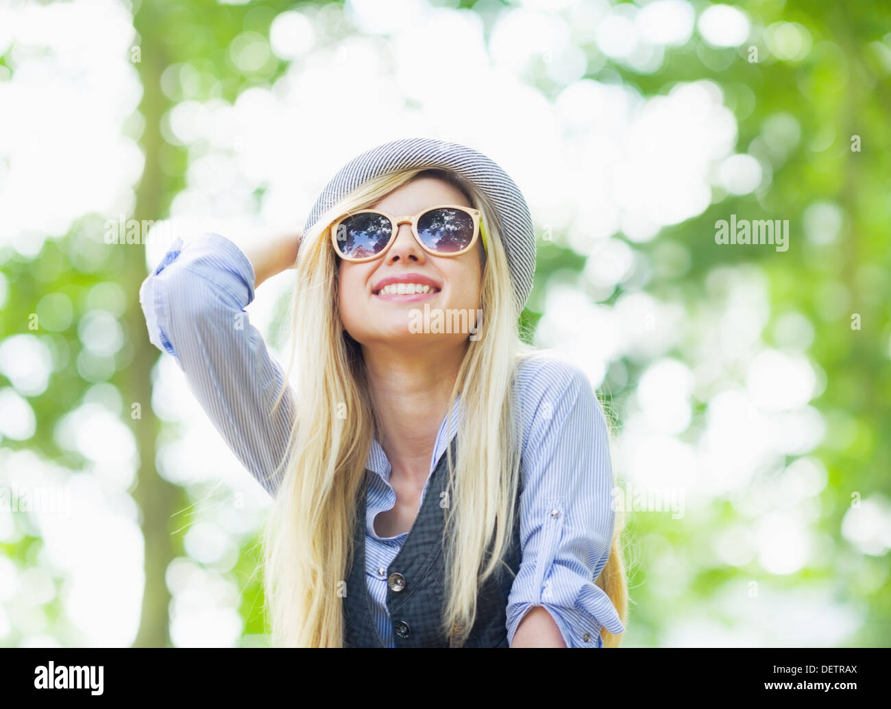 Happy hipster girl rejoicing in the park - Stock Image