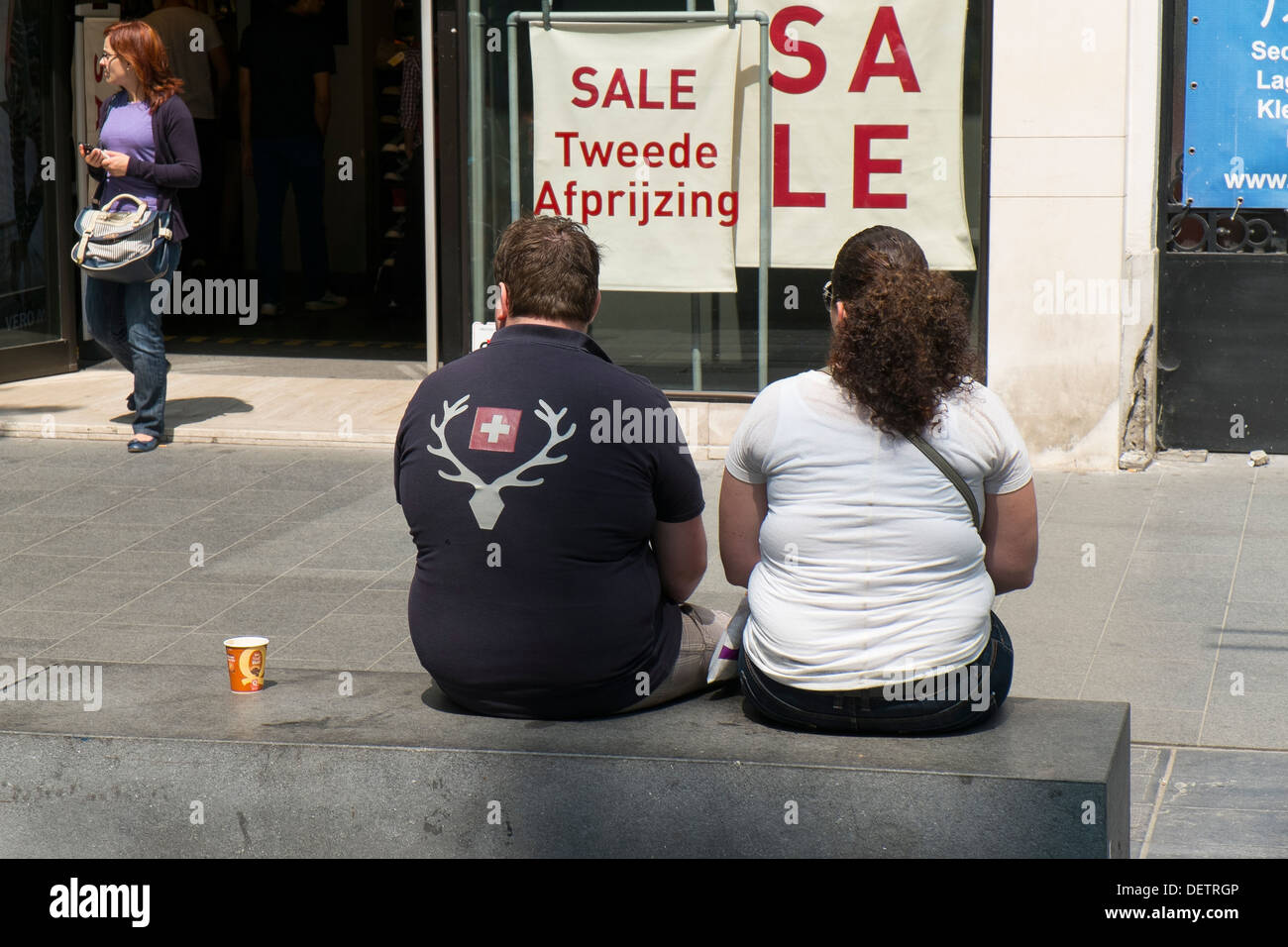 fat overweight obese man woman couple sitting seat - Stock Image