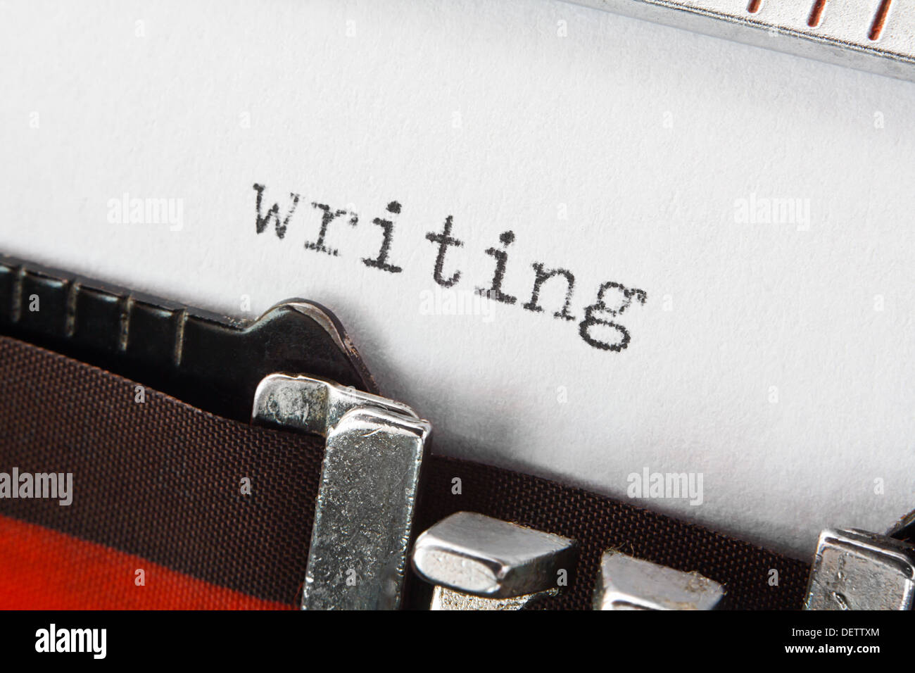 type spelling the word writing on a vintage typewriter, great concept for blogs, journalism, news, authors or the mass media - Stock Image
