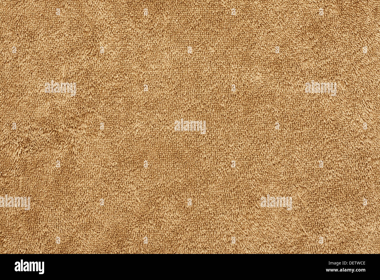 cotton twist towelling background on a beige beach towel - Stock Image