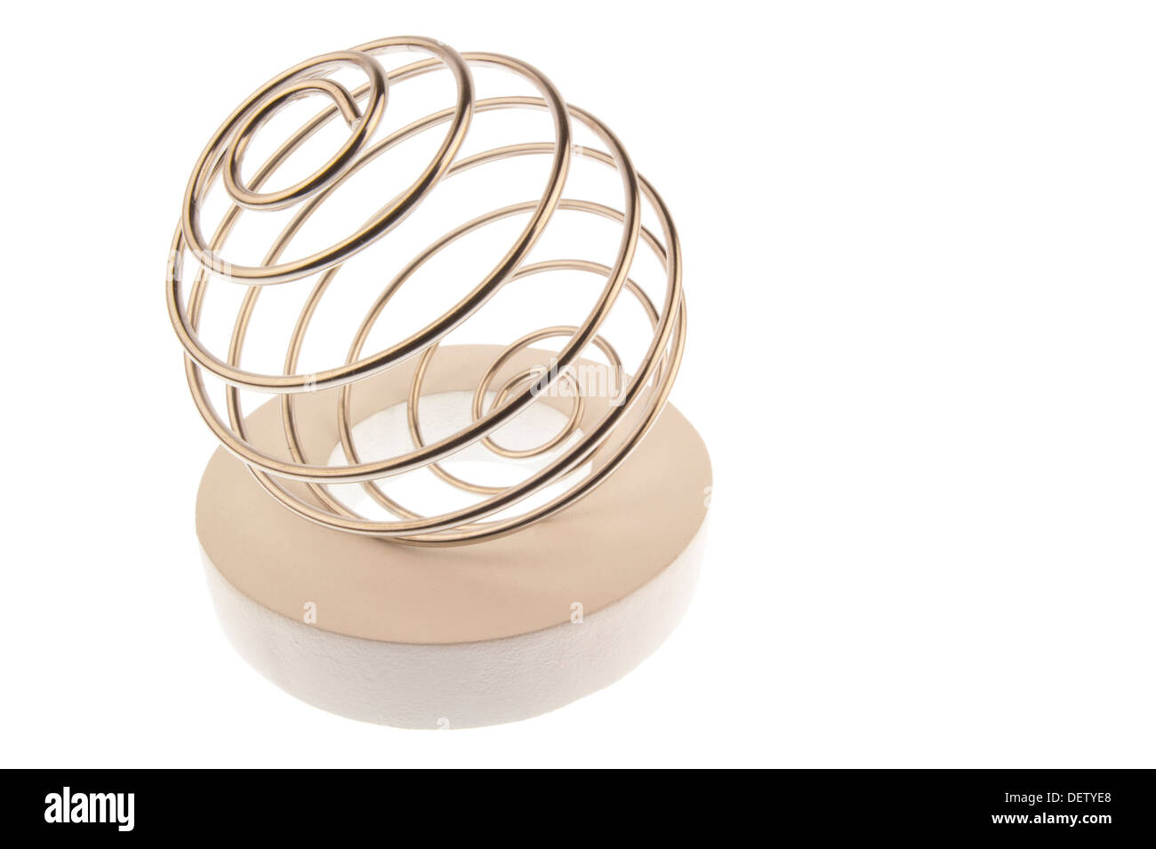 Iron wire tangled up into a spiral ball,lying tilted to the left on a white ring Stock Photo