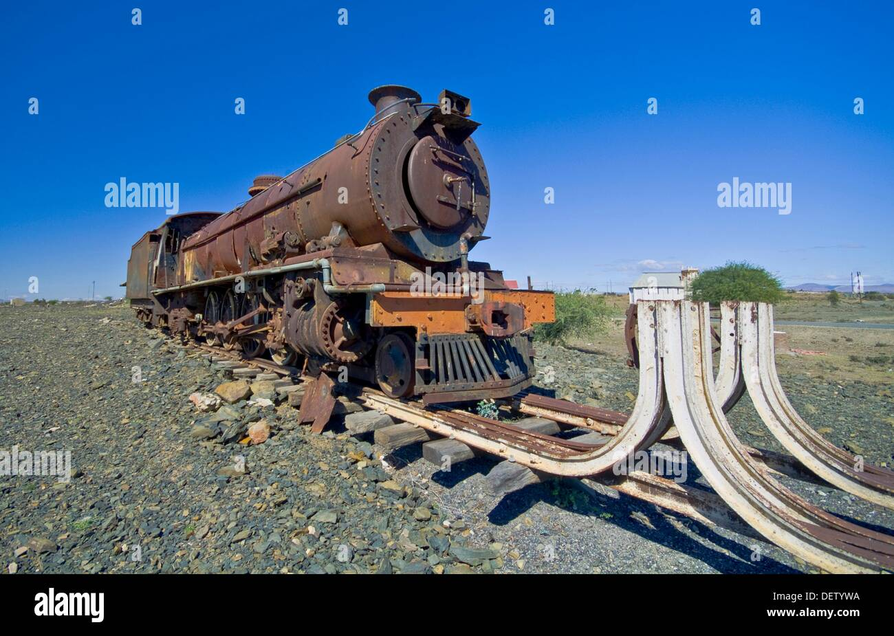 an old steam engine lies rusting at the end of the line  In the Great Karroo, South Africa Stock Photo