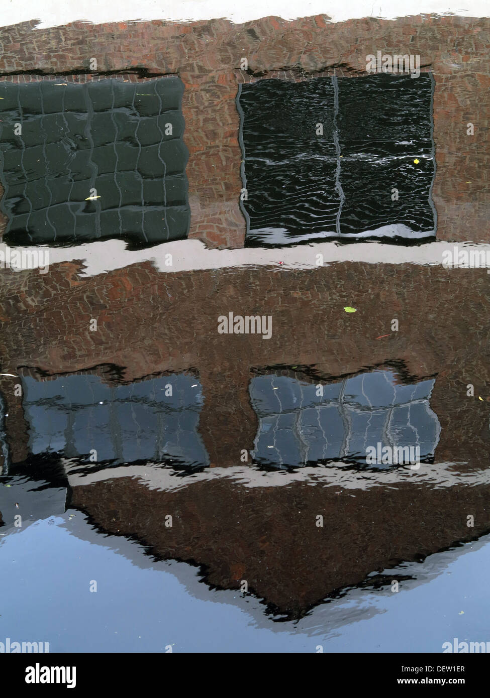 Fossgate - Reflection of brick building on the River Foss - City of York - Yorkshire - England - UK - Stock Image