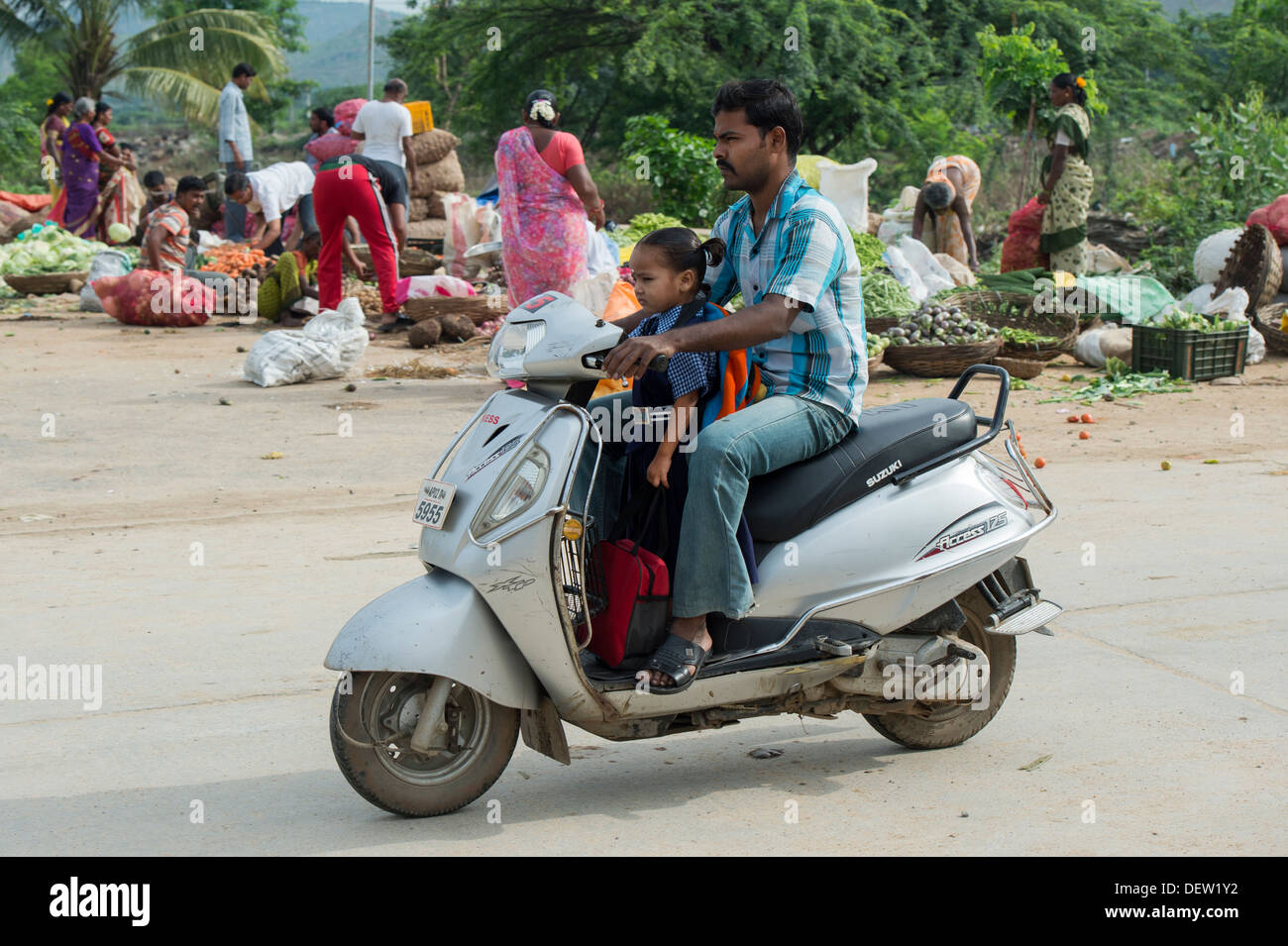 Indian father taking his daughter to school on a moped. Andhra Pradesh, India - Stock Image