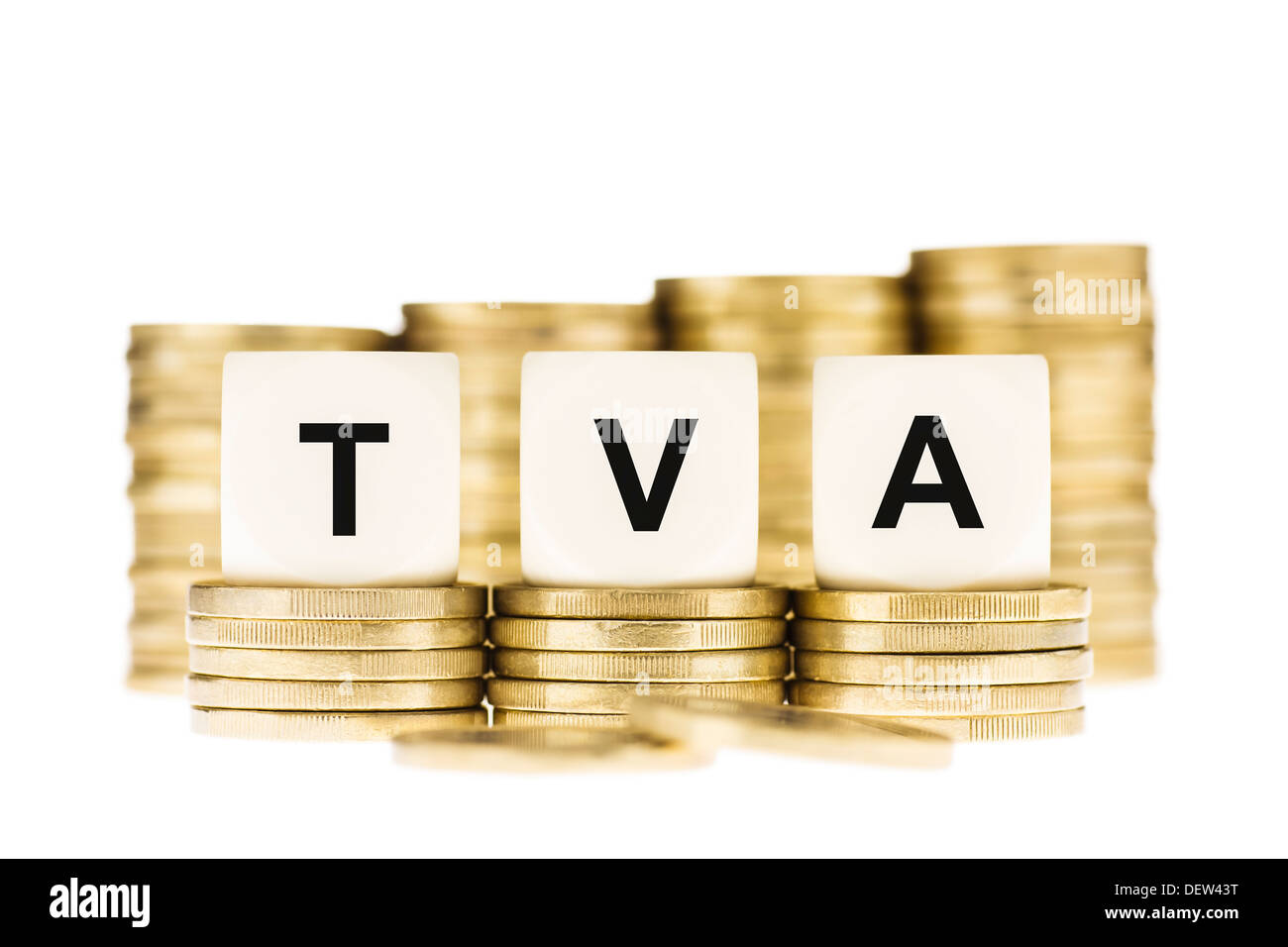 TVA (French Value Added Tax) on Piles of Gold Coins with a White Background - Stock Image